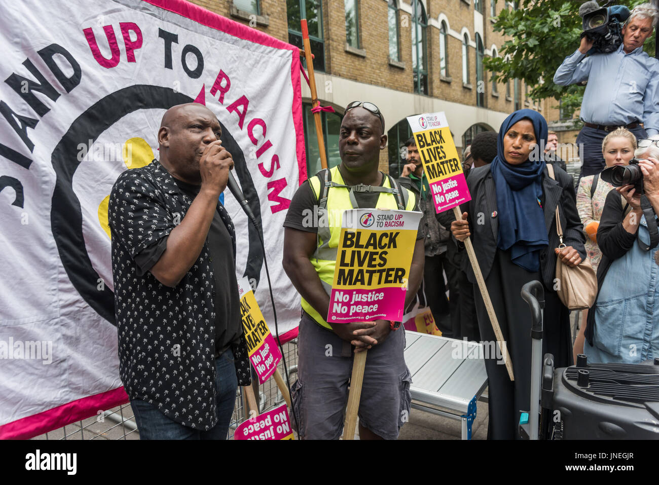 July 29, 2017 - London, UK - London, UK. 29th July 2017. Stand Up to Racism speaker at the protest at Stoke Newington - Stock Image