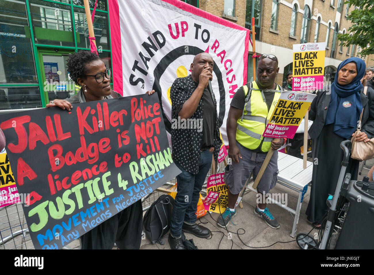 London, UK. 29th July, 2017. London, UK. 29th July 2017. A woman holds a Movement for Justice poster at the Stand - Stock Image