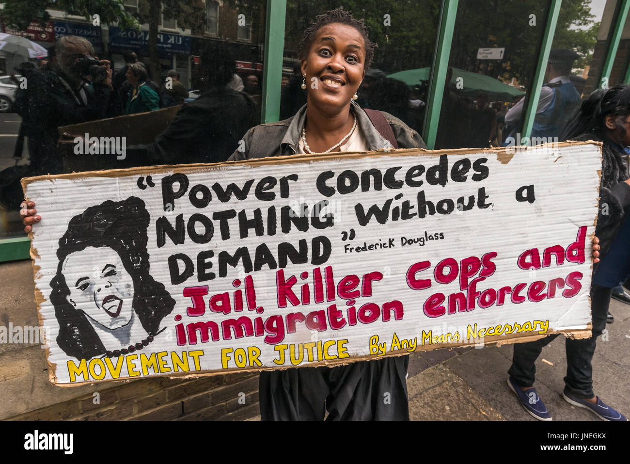 July 29, 2017 - London, UK - London, UK. 29th July 2017. A protesters holds a Movement fro Justice poster calling - Stock Image