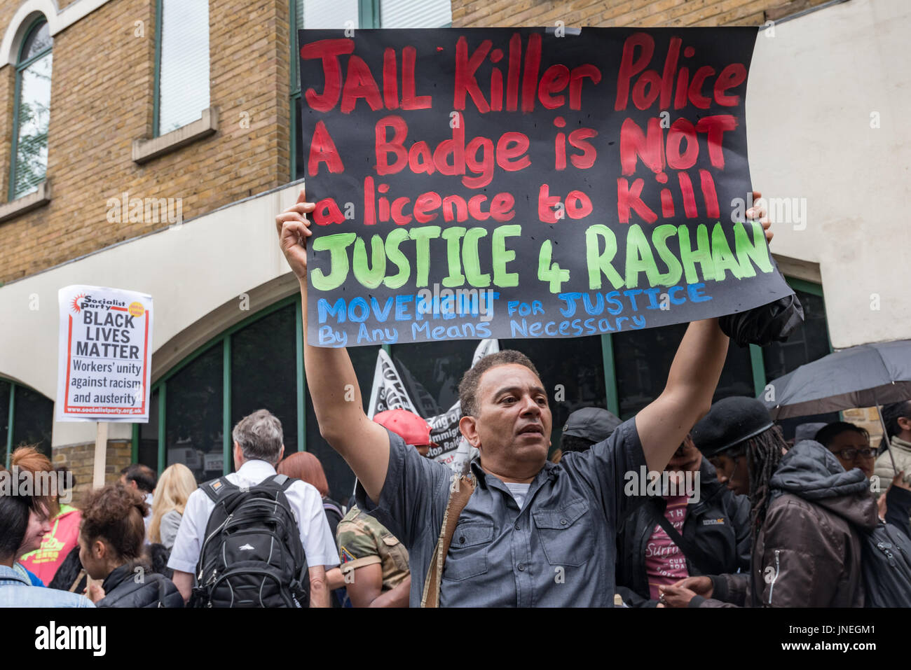 July 29, 2017 - London, UK - London, UK. 29th July 2017. A Movement for Justice member holds up a poster calling - Stock Image