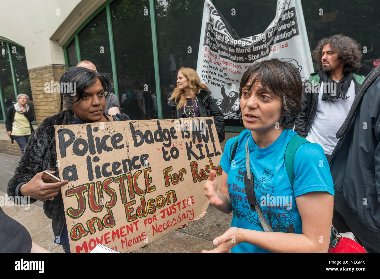 London, UK. 29th July, 2017. London, UK. 29th July 2017. Anna from Movement for Justice is interviewed at the protest - Stock Image