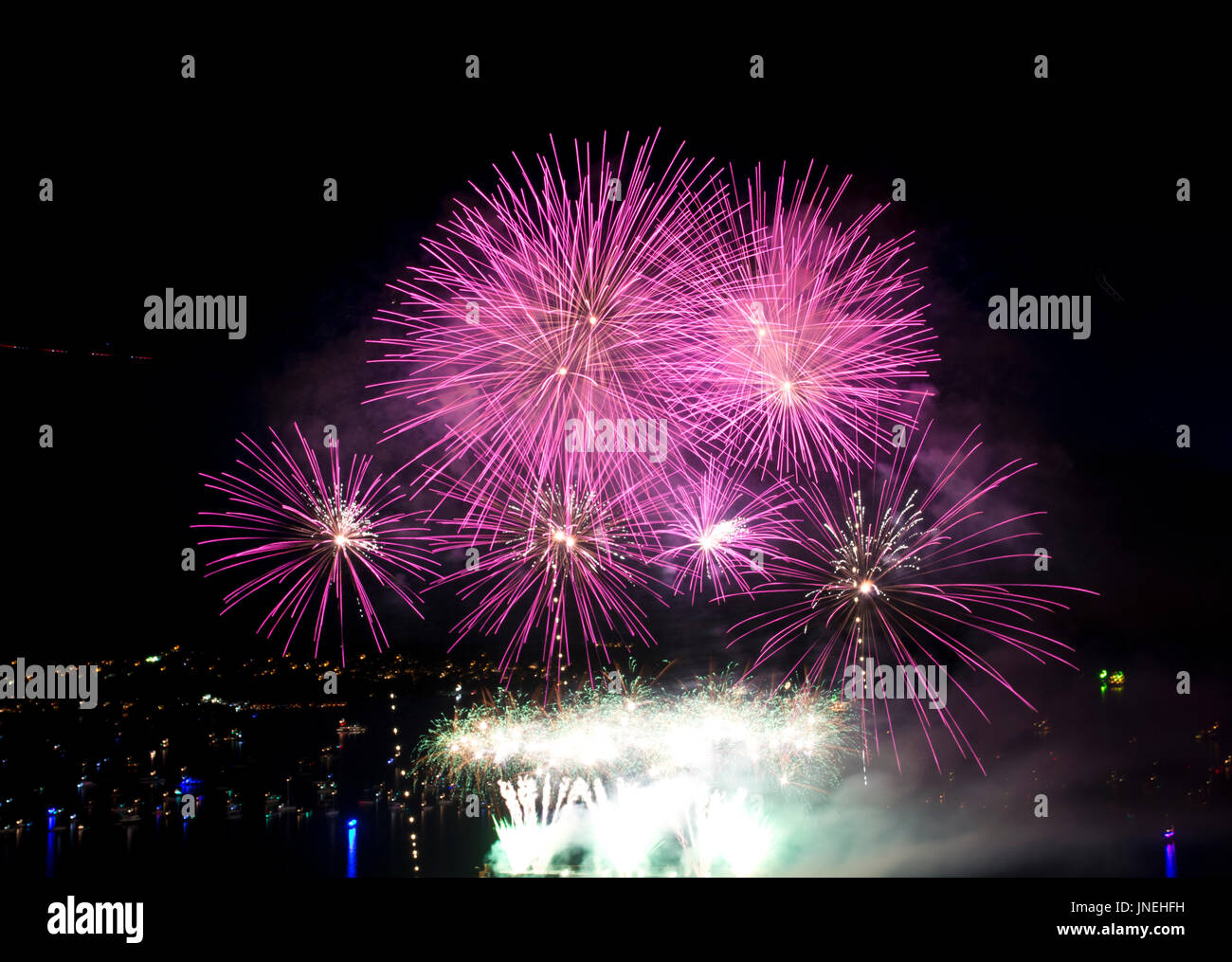 Vancouver, BC, Canada.  29th July, 2017.  Bright pink fireworks burst in the sky above the waters of English Bay Stock Photo