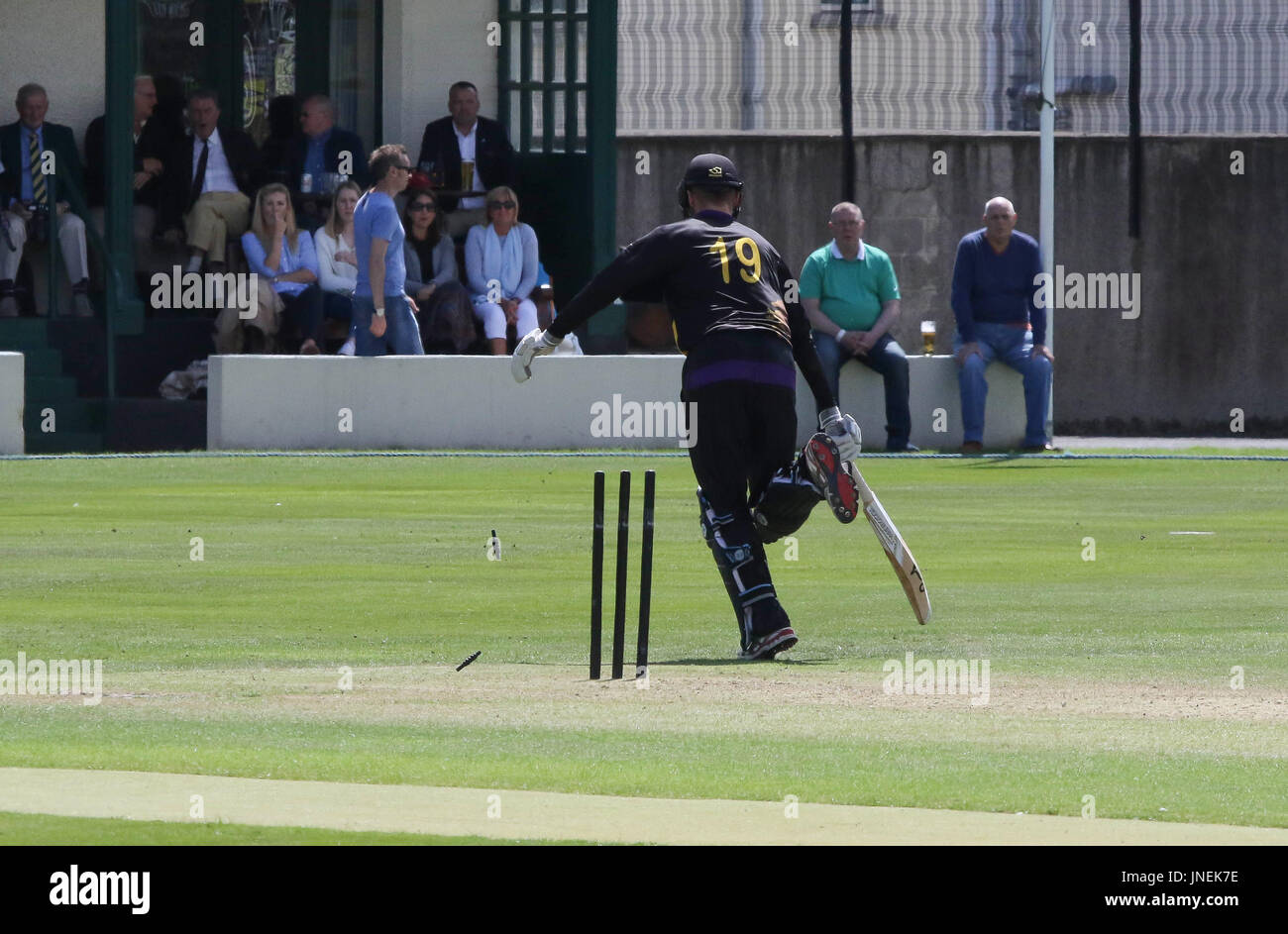 The Green, Comber, Northern Ireland, UK. 29 July 2017. CIYMS defeated Instonians by six wickets to win the Arthur J Gallagher Cup Final. Instonians' Nathan Smith is run out following a direct hit on the stumps. Credit: David Hunter/Alamy Live News. - Stock Image