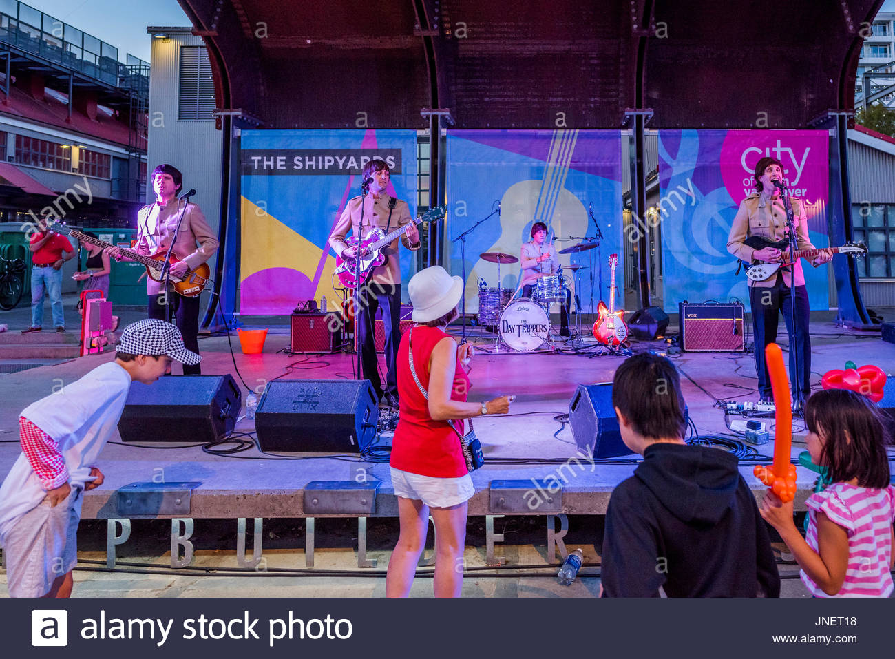 Vancouver, Canada. 29th July, 2017. Audience dances to Beatles cover band  The Day Trippers play The Shipyards at Stock Photo