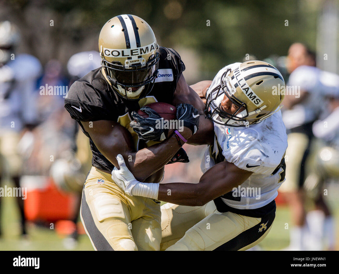Metairie, Louisiana, USA. 30th July, 2017. New Orleans Saints wide receiver Brandon Coleman (16) sheds the tackle Stock Photo