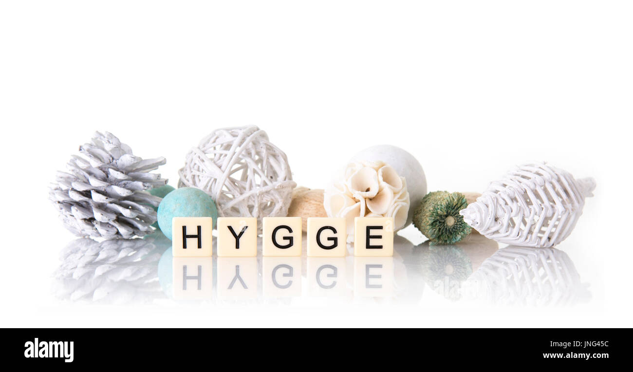 Hygge spelt with word tiles on a simple white background with copyspace. - Stock Image