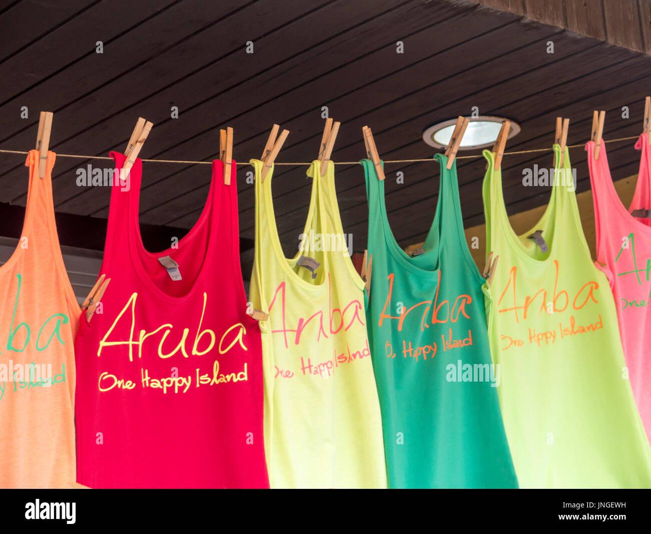 Souvenir shirts  for Sale at a tourist market In Oranjestad , Aruba - Stock Image