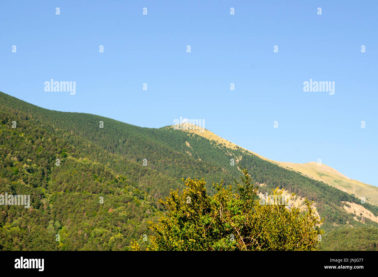 the moon sets over the Pyrenees mountains at Fuerte de Sta Elena (The fort at Santa Elena), Pyrenees Mountains, Stock Photo