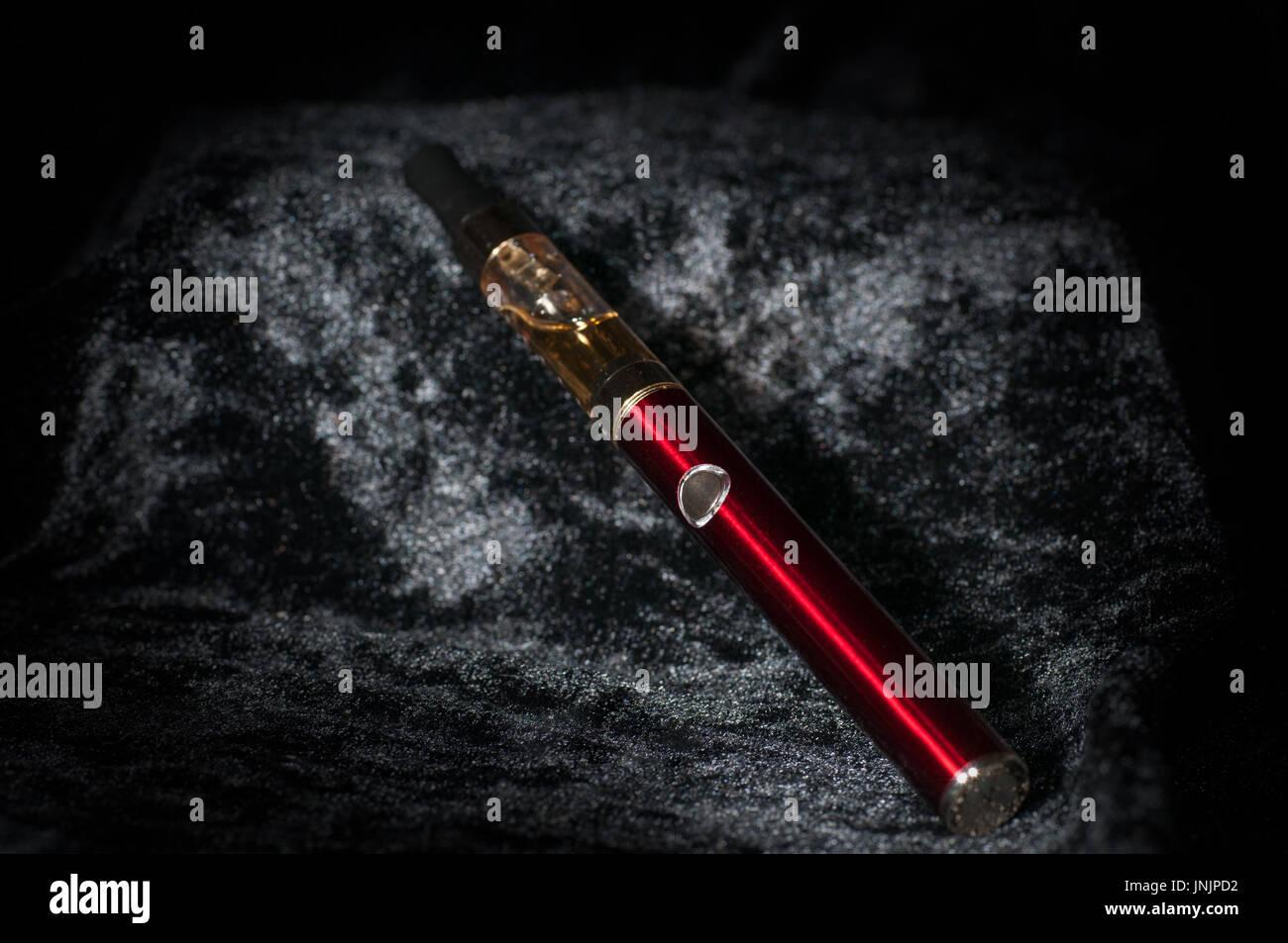 electronic cigarette with smoke - Stock Image
