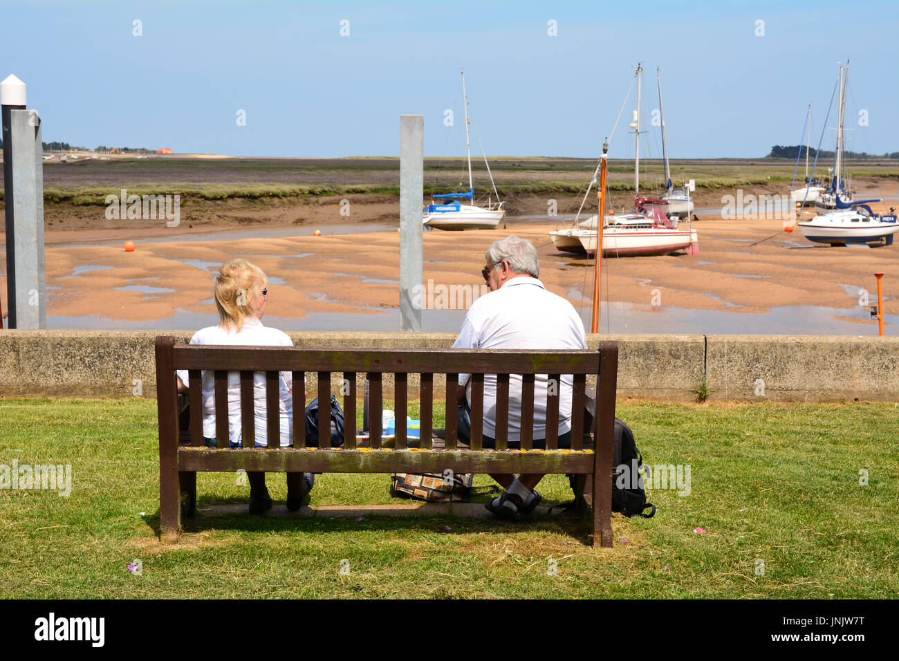 Strange Elderly Couple Sat On Wooden Bench Looking At The Boats In Evergreenethics Interior Chair Design Evergreenethicsorg