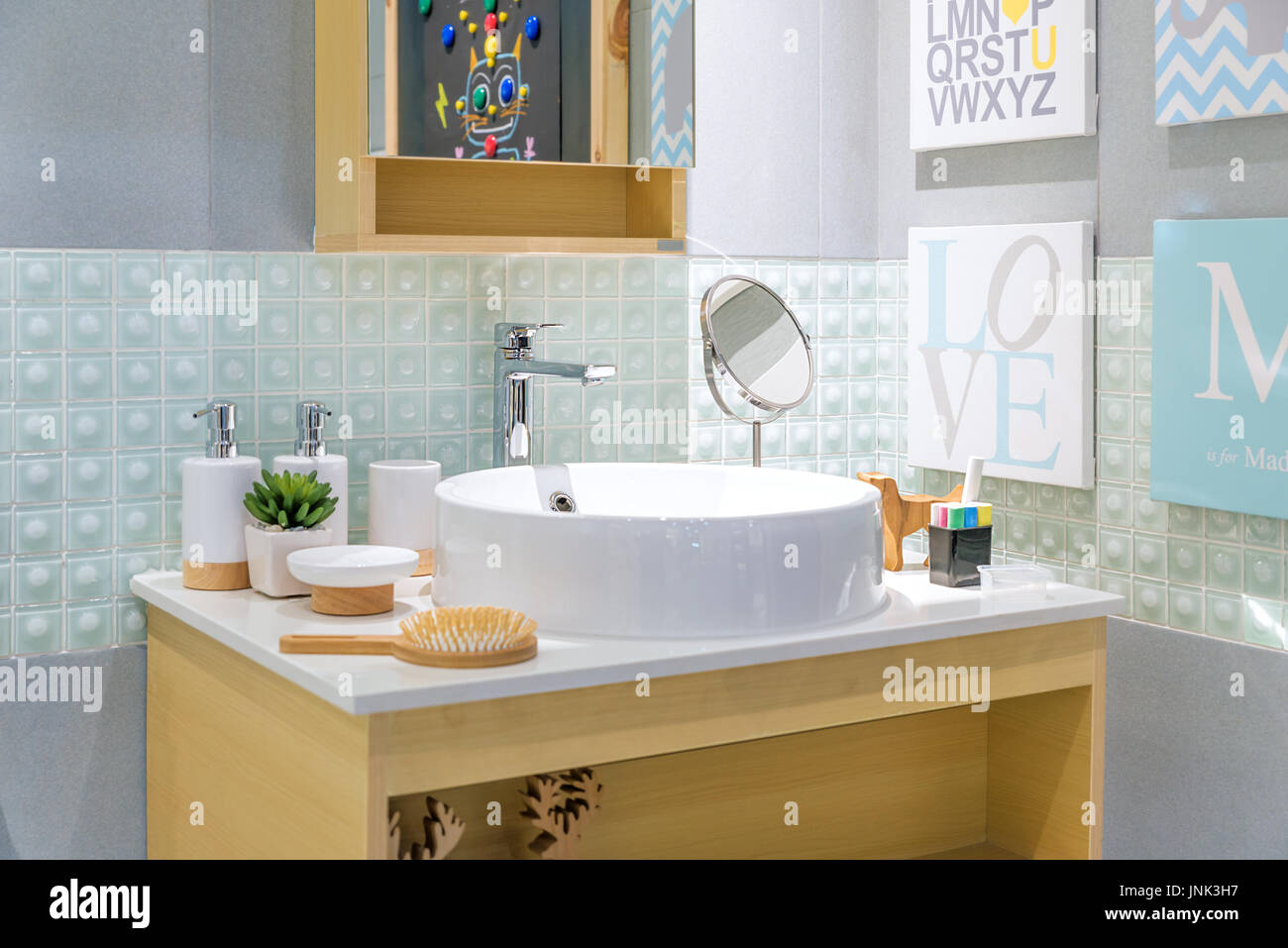 Interior of bathroom with sink basin faucet and mirror. Modern design of bathroom. - Stock Image