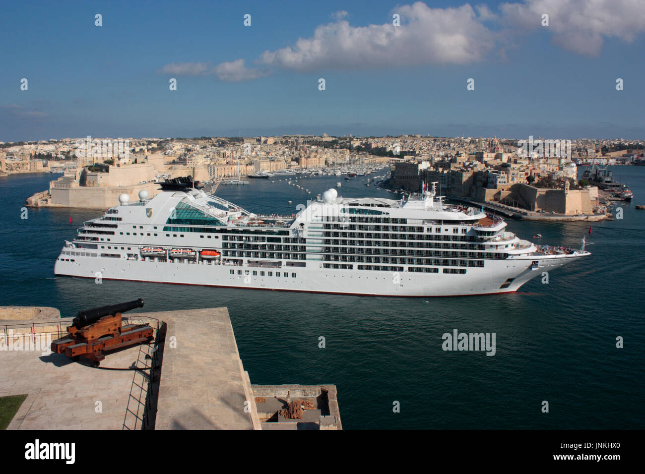 Mediterranean holiday travel and tourism. The modern cruise ship or liner Seabourn Encore entering the Grand Harbour in Malta, Europe - Stock Image