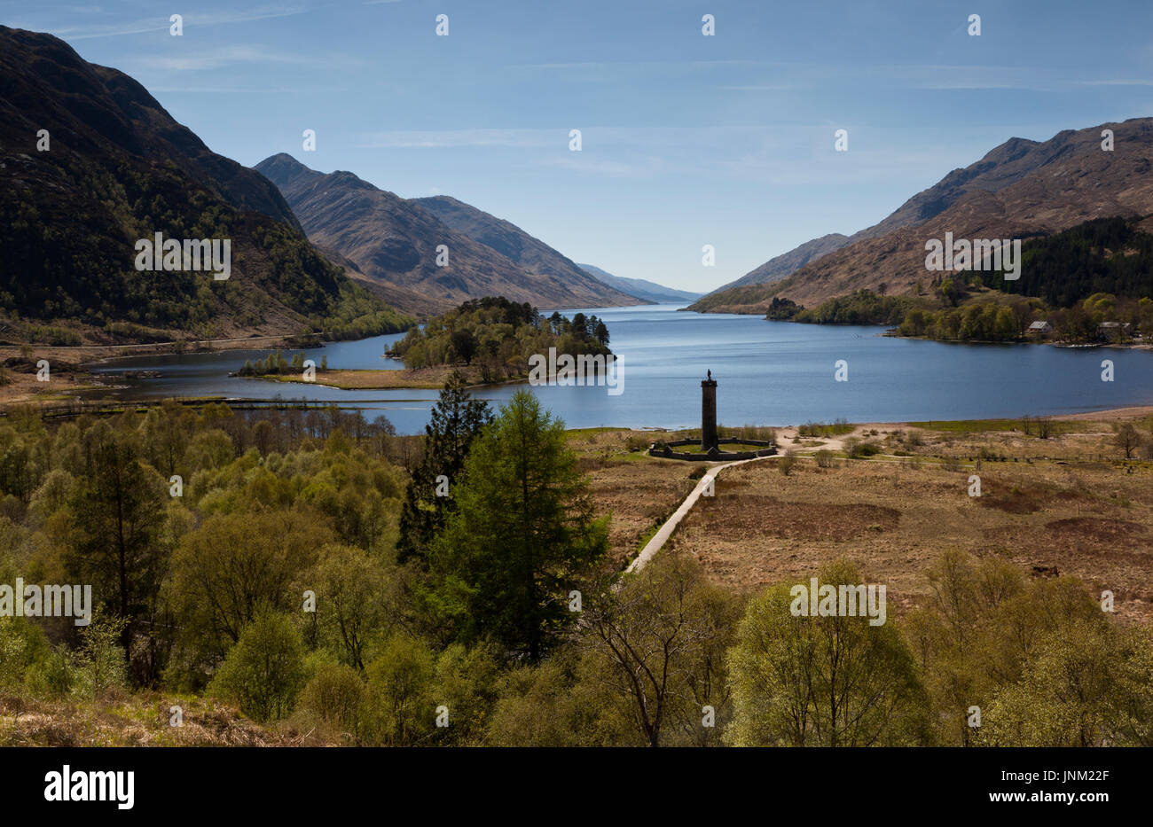 The Glenfinnan Monument standing at the head of Loch Shiel, Scotland, UK - Stock Image