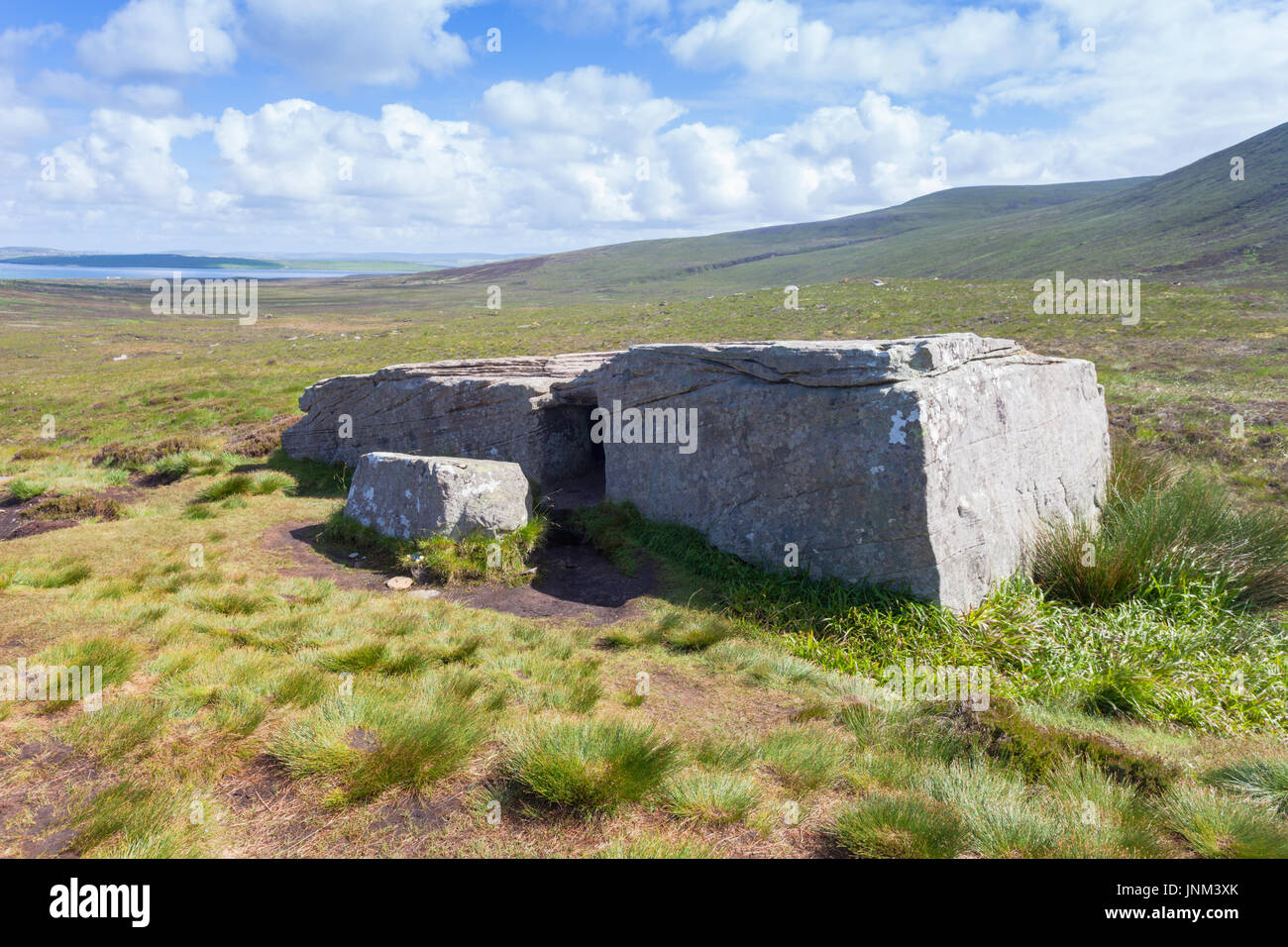 The Dwarfie Stane, a megalithic chambered tomb carved out of a block of Devonian Old Red Sandstone located in a steep-sided glaciated valley - Stock Image