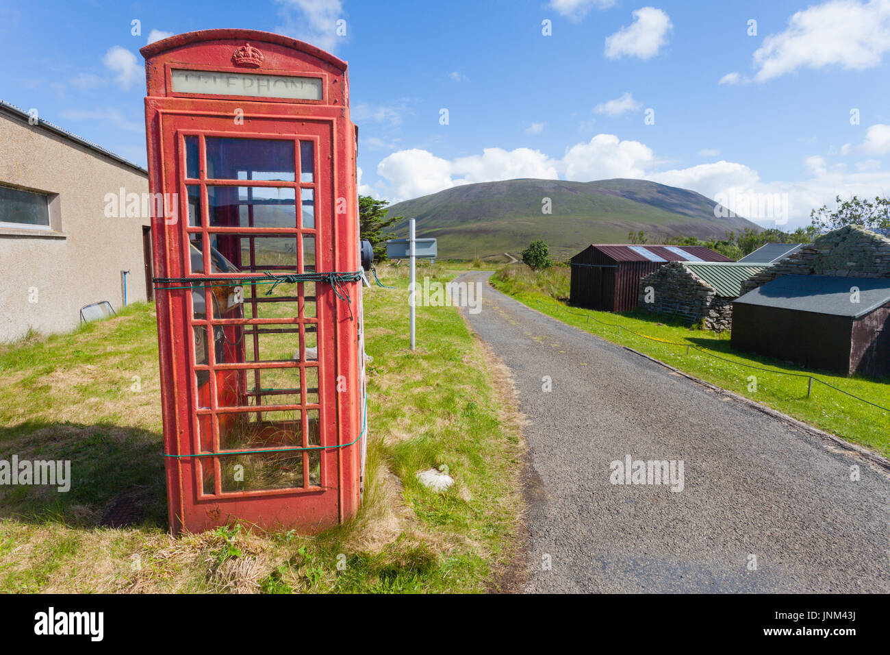 Old disused traditional British red phone box kiosk, Hoy, Orkney UK - Stock Image