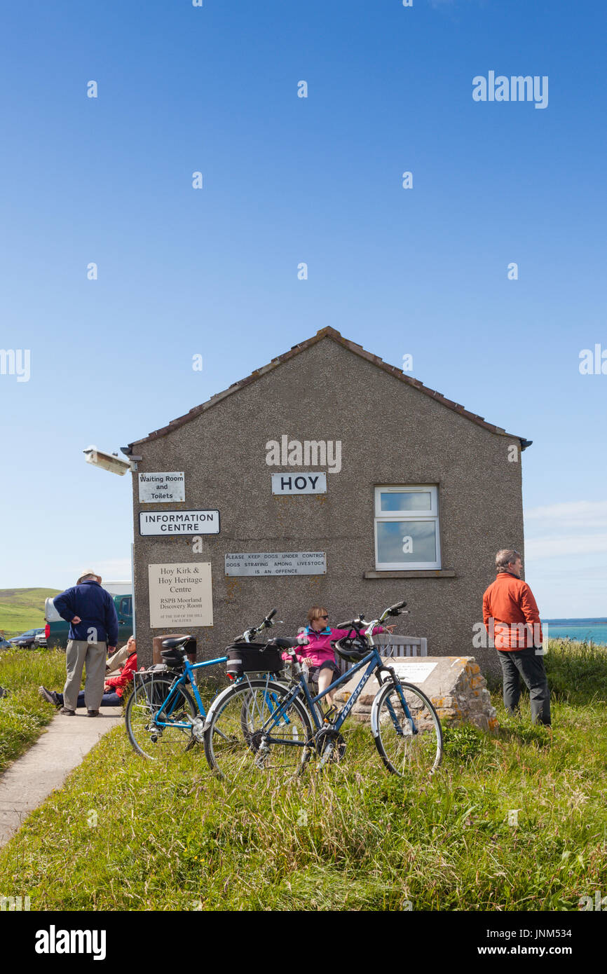 Two cyclists waiting for the ferry on Hoy to mainland Orkney, UK Stock Photo