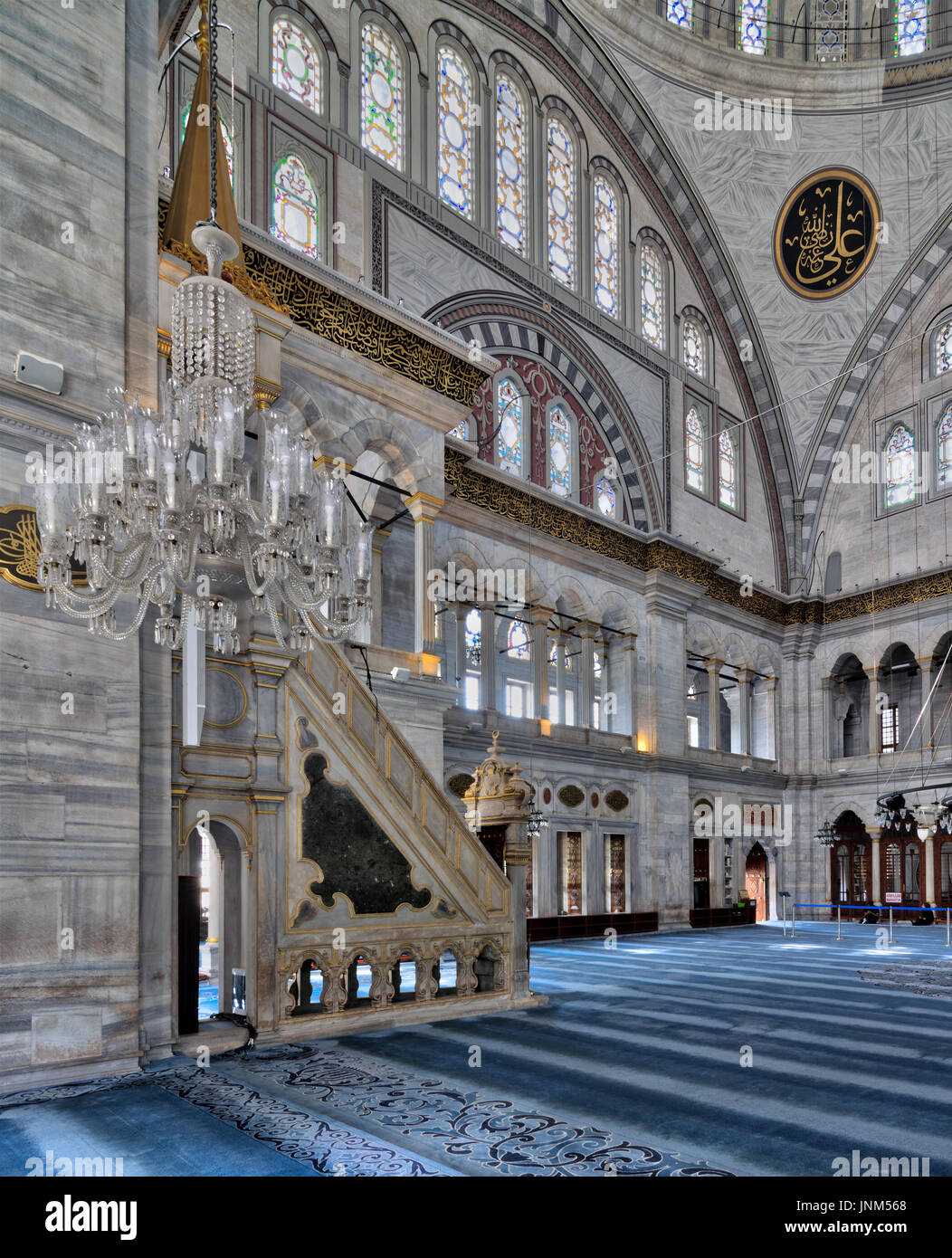 Interior facade of Nuruosmaniye Mosque, an Ottoman Baroque style mosque completed in 1755, with a huge arch & many colored stained glass windows locat - Stock Image