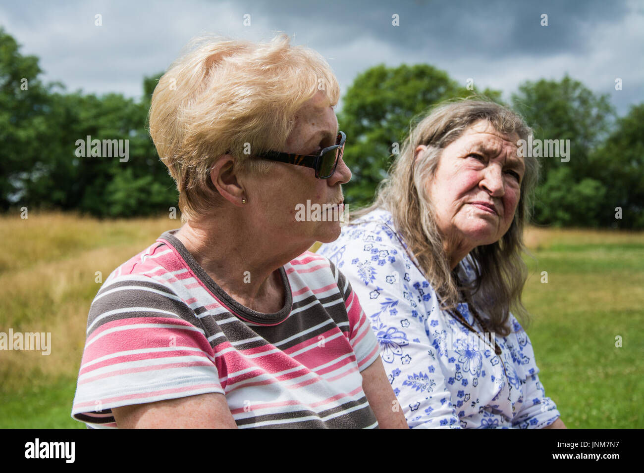 Two elderly women worrying about the future, concerned about their pensions, anxious about the state of the nation. UK. - Stock Image
