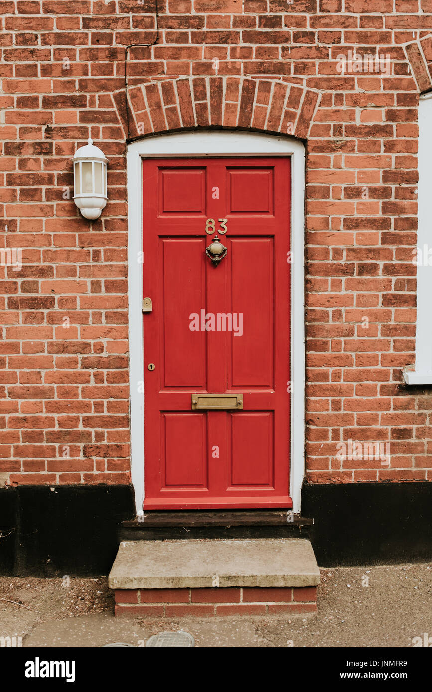 Classic red wooden door in England - Stock Image