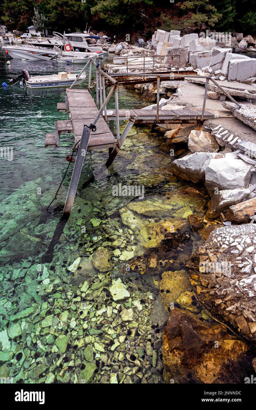Ramshackle Harbour at Skala Panagia, Thassos. Stock Photo