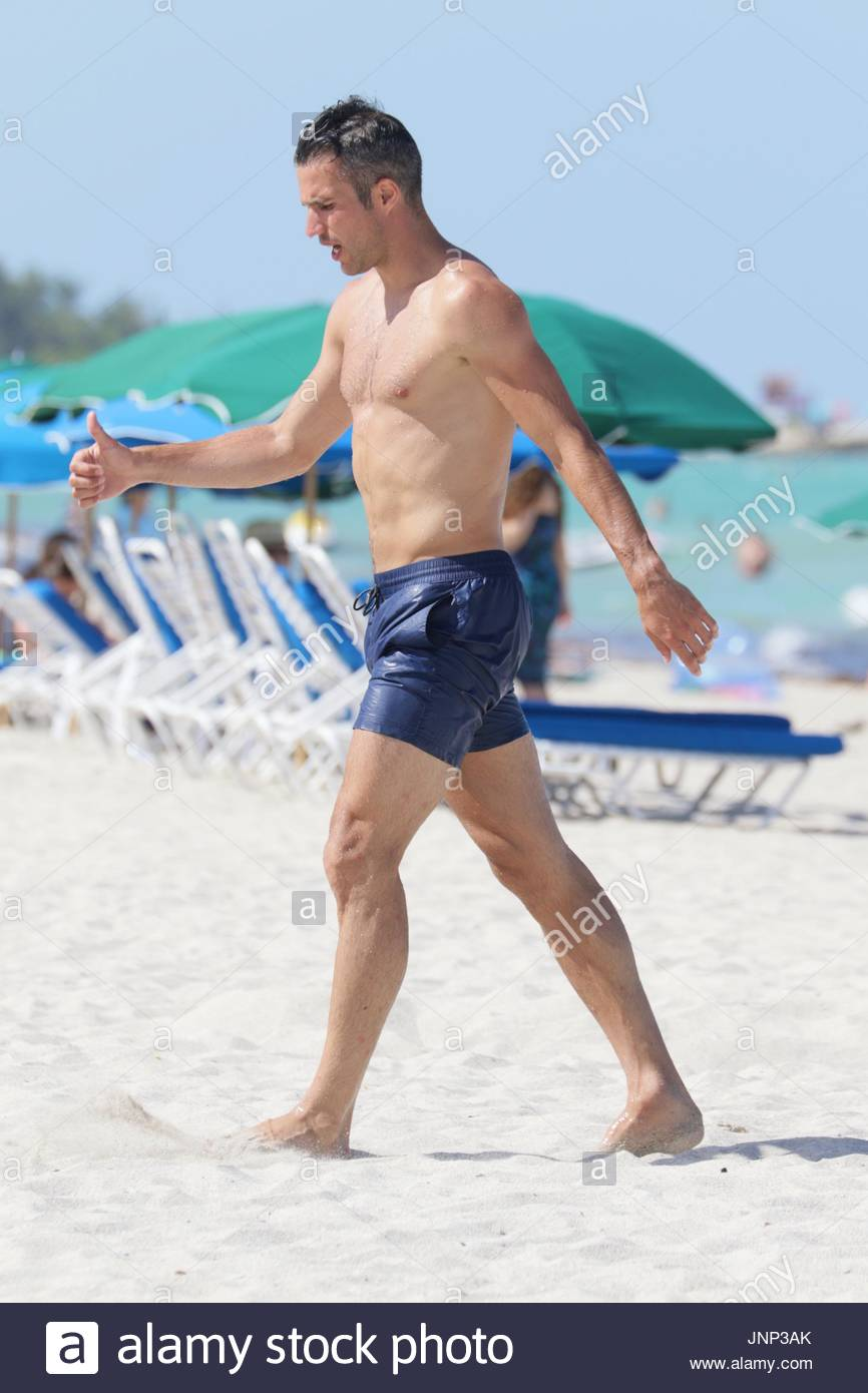 Robin van persie manchester united striker robin van persie 31 robin van persie manchester united striker robin van persie 31 shirtless on the beach in miami beach fl robin played with an american football with his voltagebd Choice Image