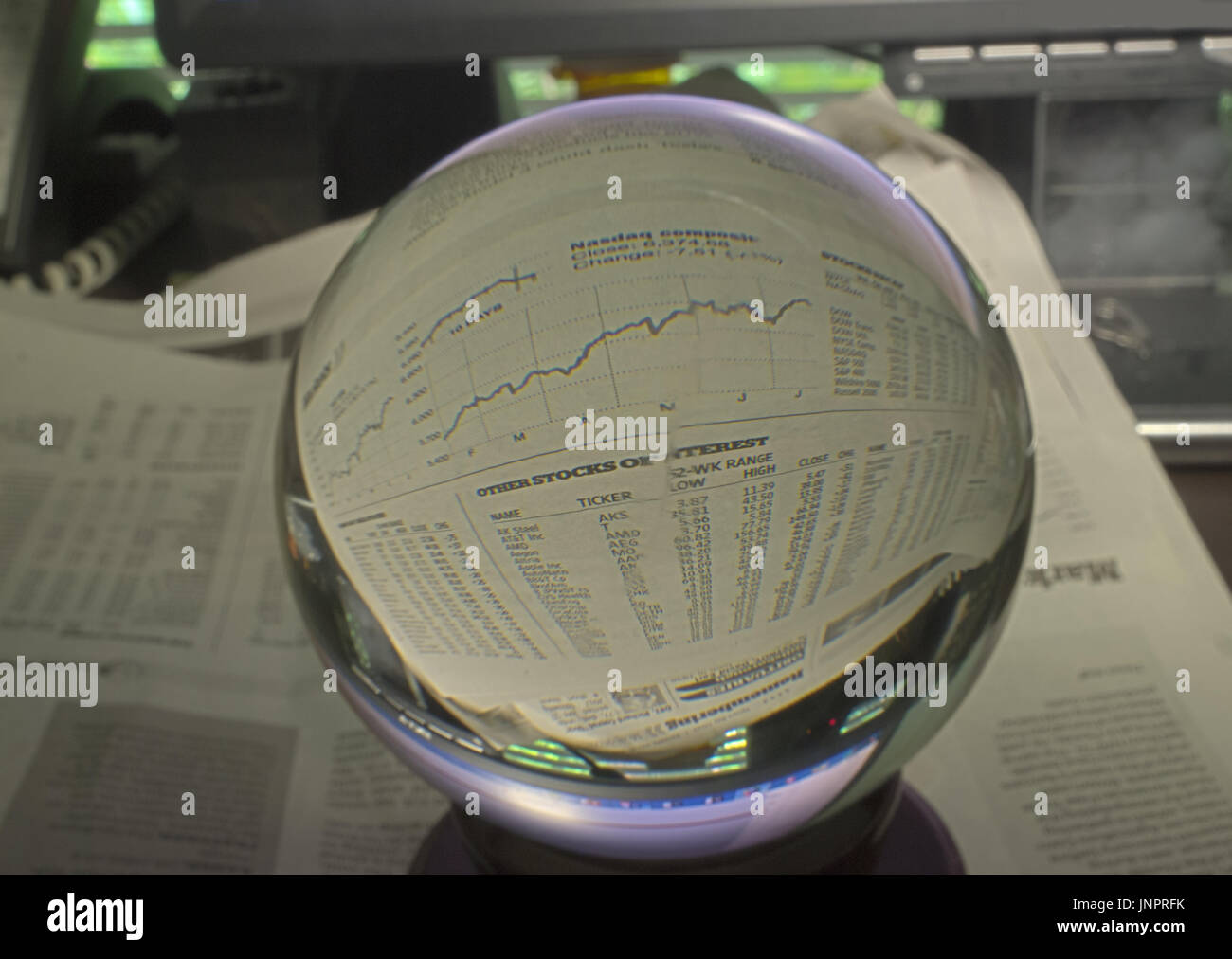 HDR Photo image of stock market graph through a crystal ball - Stock Image