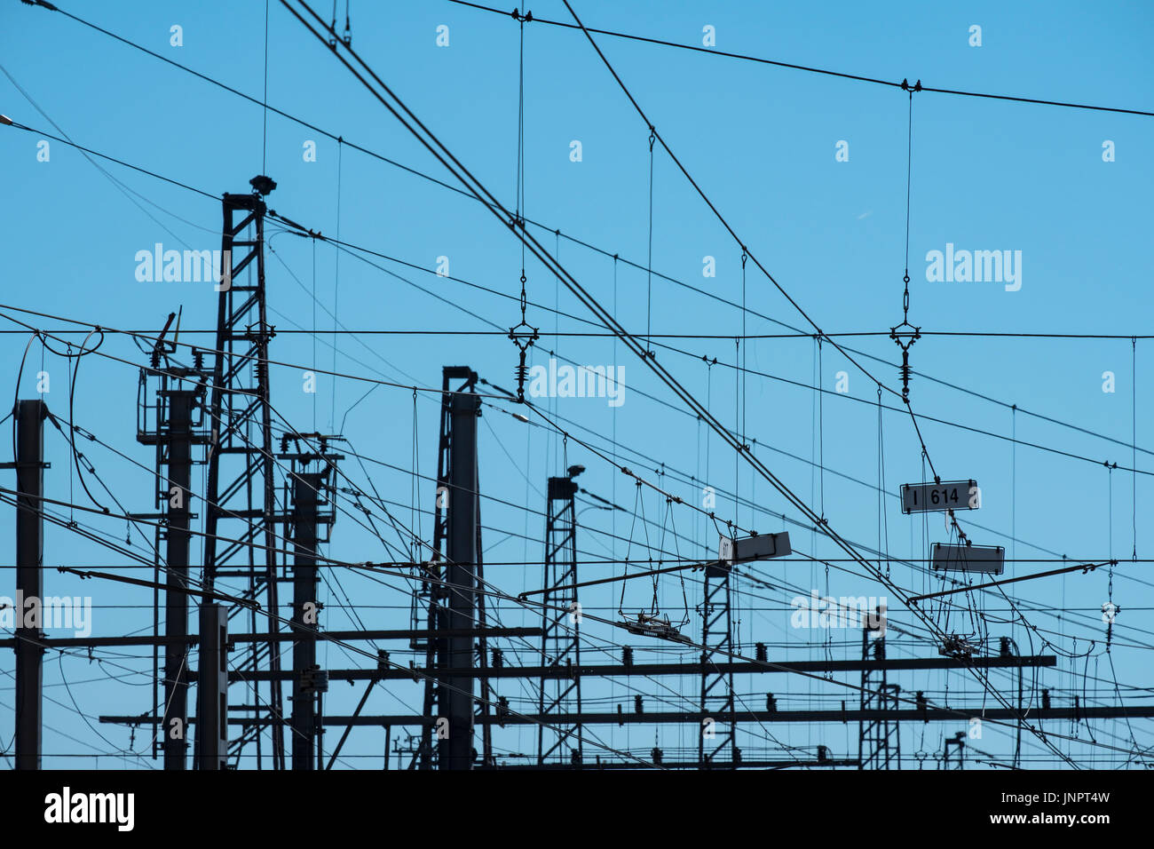 Web of overhead railway electricity cables - Stock Image