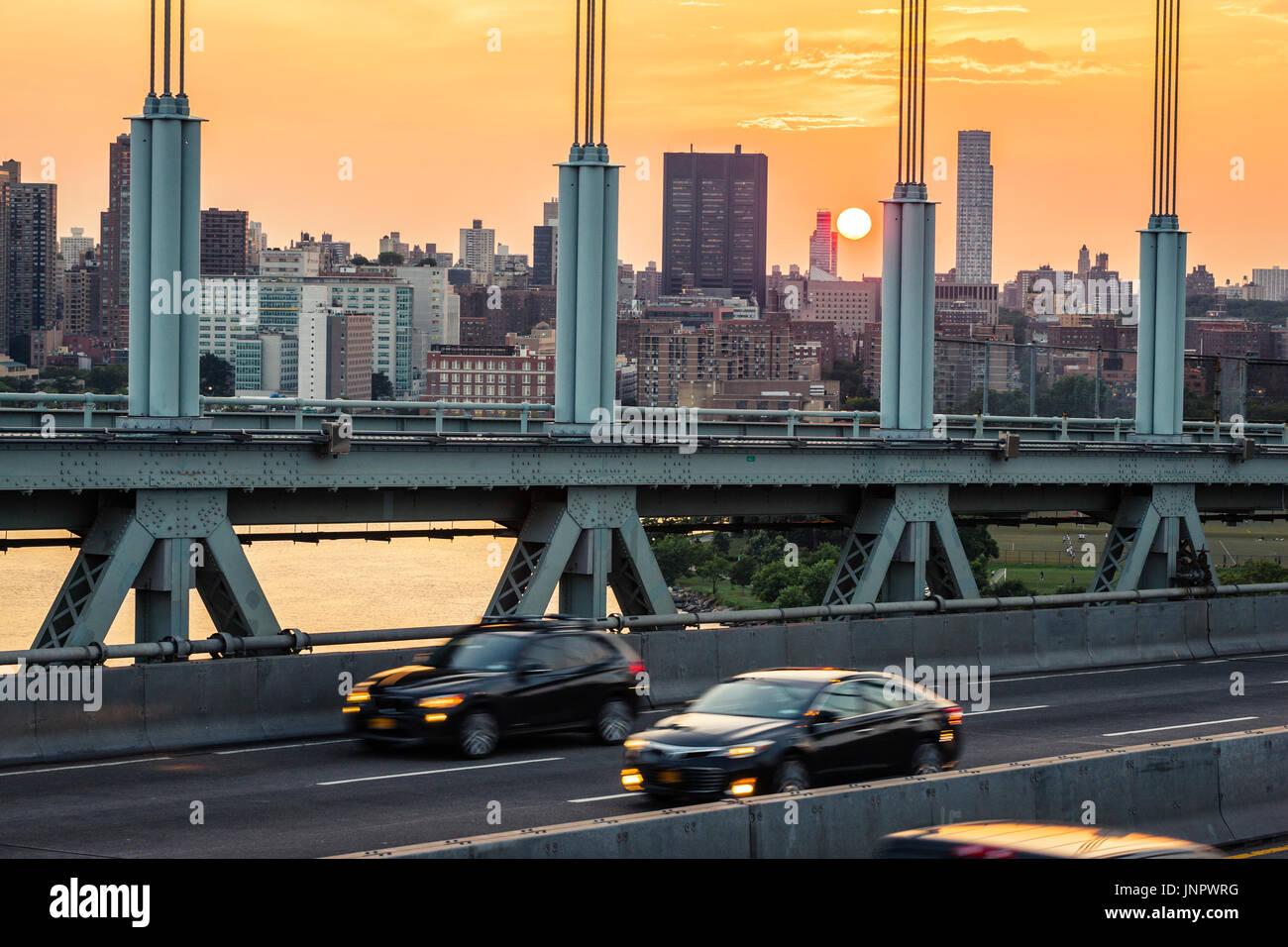 Traffic on Triborough Bridge, the Robert F. Kennedy Bridge in New York City at sunset - Stock Image