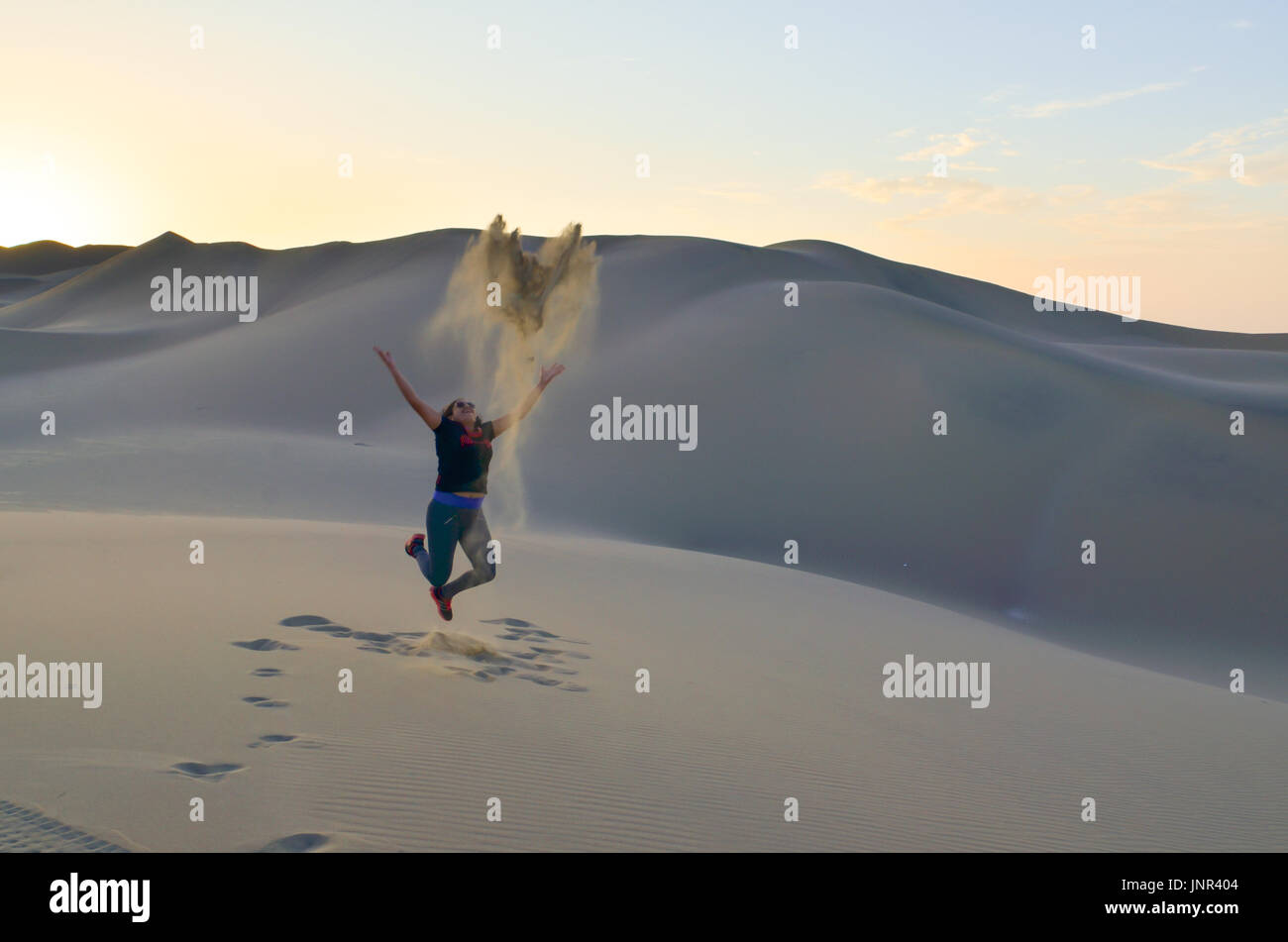 Woman enjoying the desert - Stock Image
