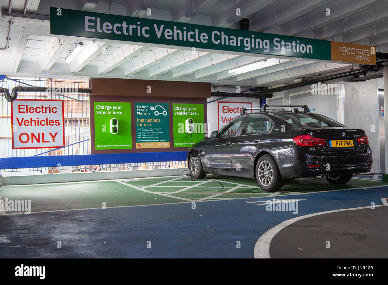 An electric vehicle charging station, also called EV charging station, electric recharging point, charging point, charge point and EVSE in Preston, Lancashire, UK - Stock Image