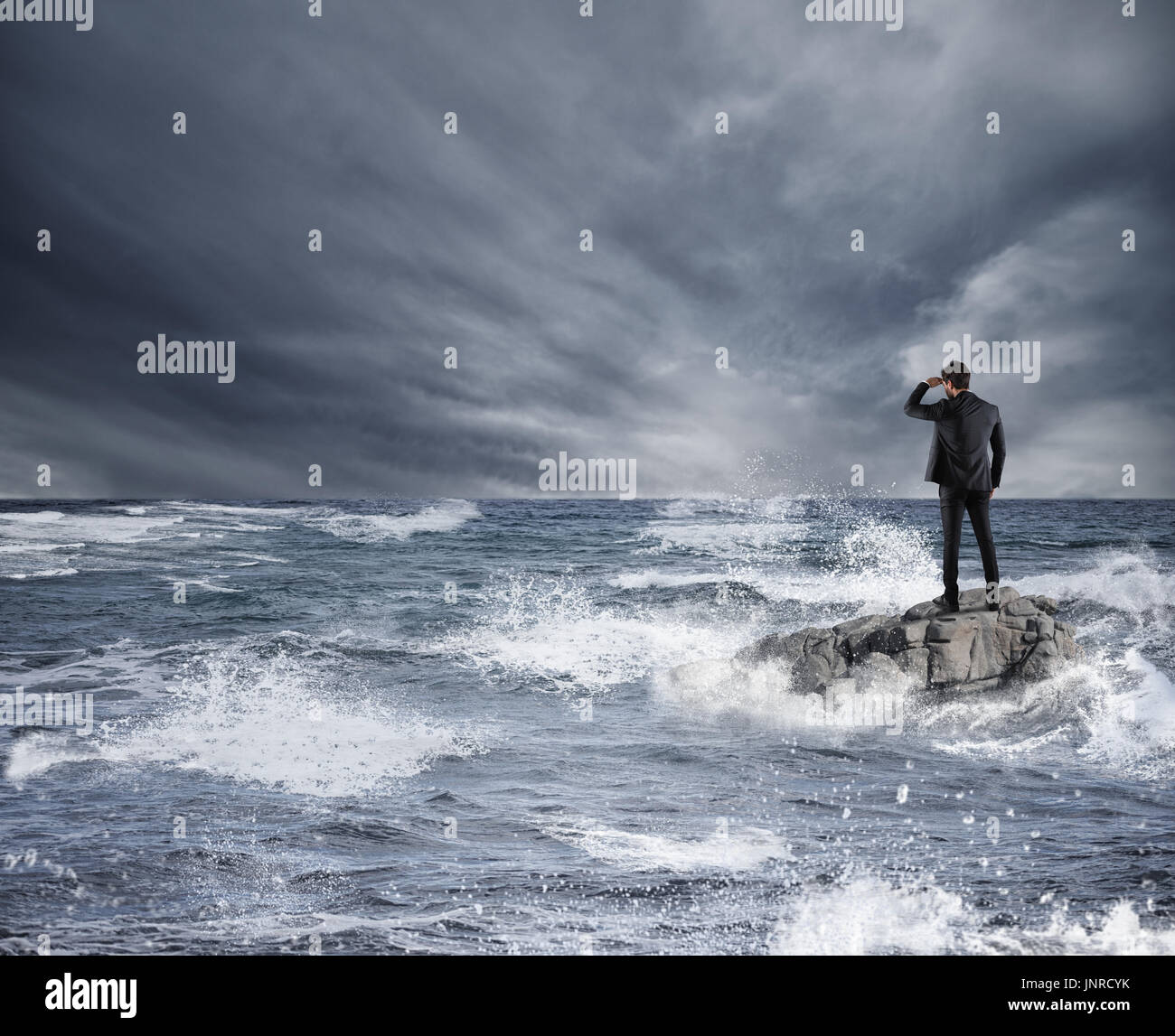 Businessman looking for the future during storm in the sea. Concept of economic crisis and problem - Stock Image