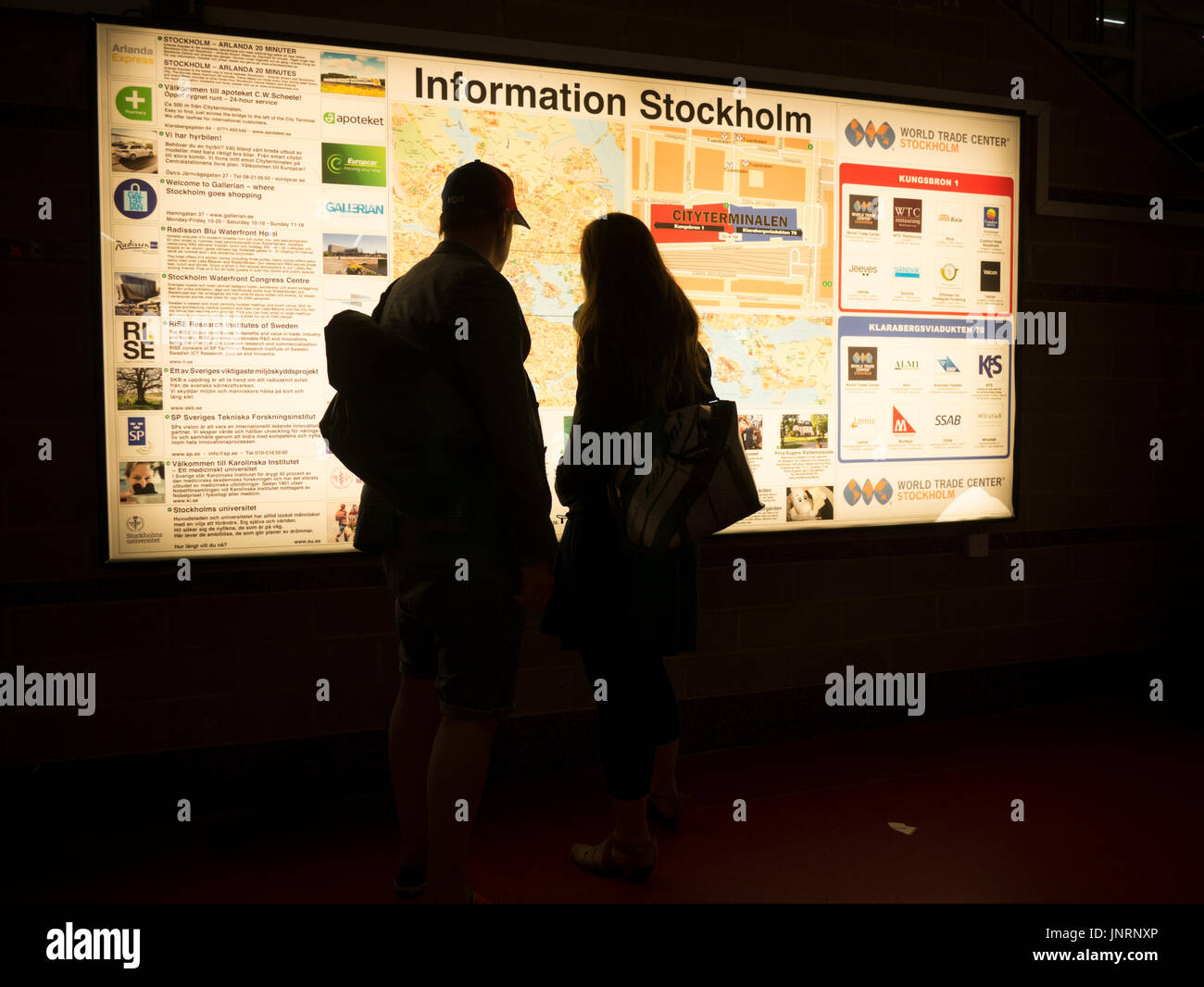 Tourists looking at information board map at Centralstation central ...