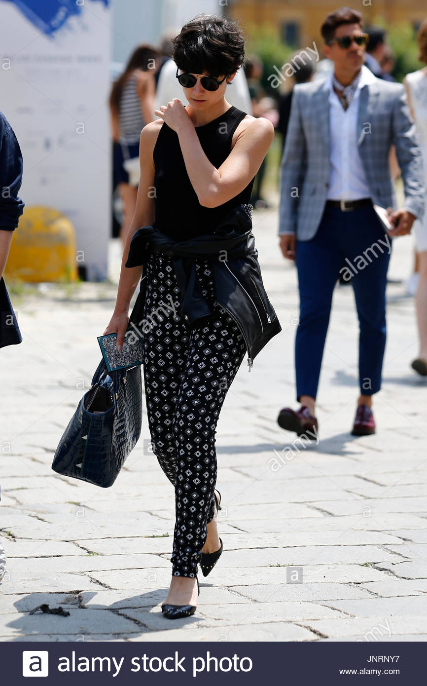 bc667c0072d Guests arrive and pose for street fashion at the Gucci Fashion Show as part  of Milan Fashion Week Menswear Spring Summer 2016 in Milan on June 22