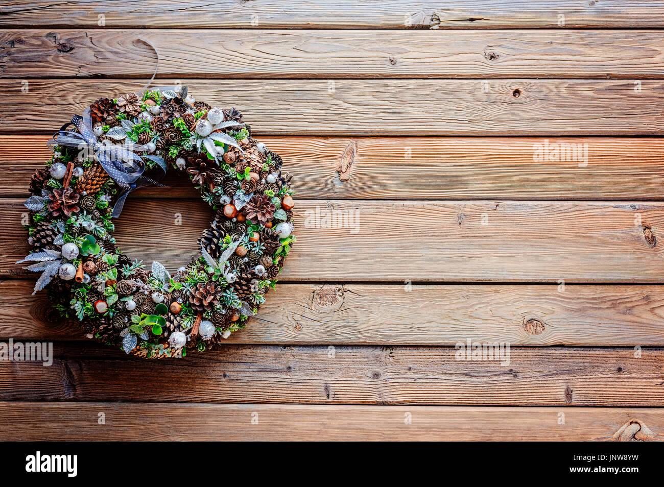 Christmas Wreath On Wooden Rustic Background Space For Text Merry