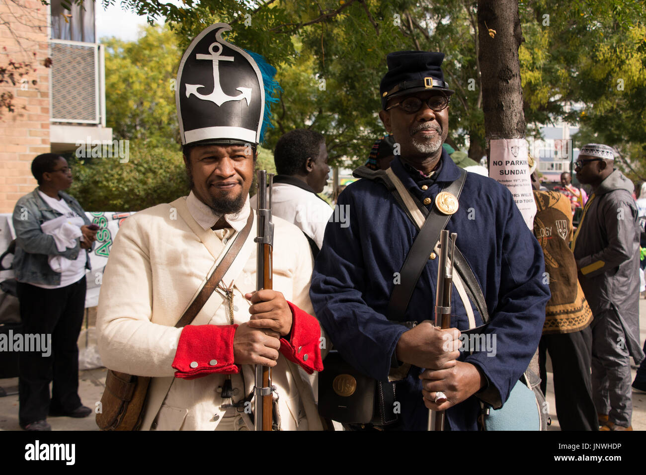African-American Revolutionary War (left) and Civil War (right) reenactors join the African Day Parade in Harlem. - Stock Image