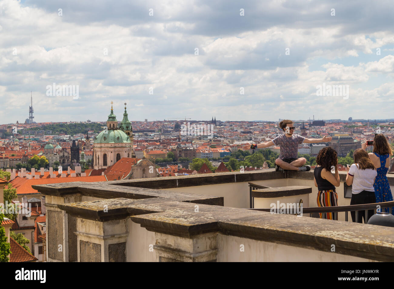 Few tourists at a vantage point and scenic view of the Mala Strana District (Lesser Town) and beyond in Prague, Stock Photo
