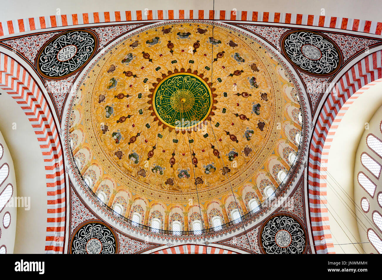 Mosque dome with its typical and multicolored decoration in a mosque in Istanbul - Stock Image