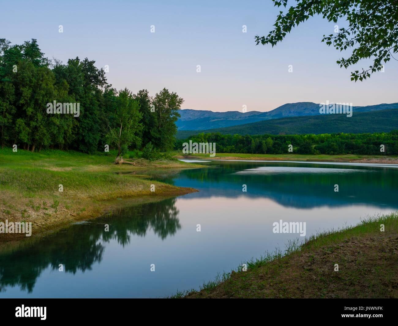 Peruca lake in Croatia dusk evening time calm calmness Stock Photo