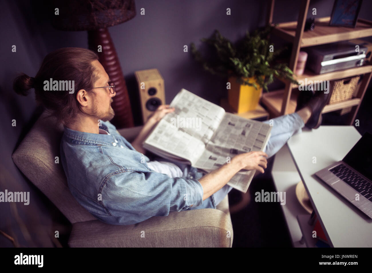 Swell Freelancer Sitting In Chair Putting Legs On Coffee Table Theyellowbook Wood Chair Design Ideas Theyellowbookinfo