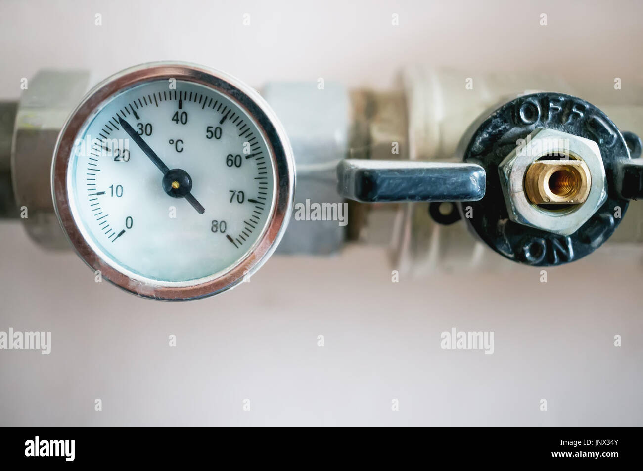 Pressure gauge for regulating the temperature of the water in the heating system. - Stock Image