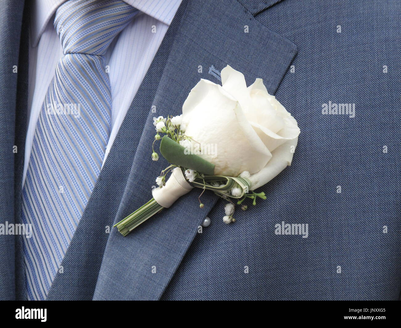 White rose on the lapel of a bridegroom Stock Photo