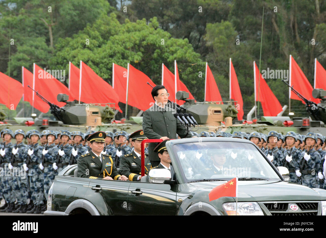 HONG KONG, China - Chinese President Hu Jintao stands in an open-top vehicle as he moves down a line of People's Liberation Army personnel stationed in Hong Kong on June 29, 2012. Hu began a three-day visit to Hong Kong to celebrate the 15th anniversary of its return to Chinese rule and to preside over the swearing-in of the territory's new administration. (Kyodo) Stock Photo