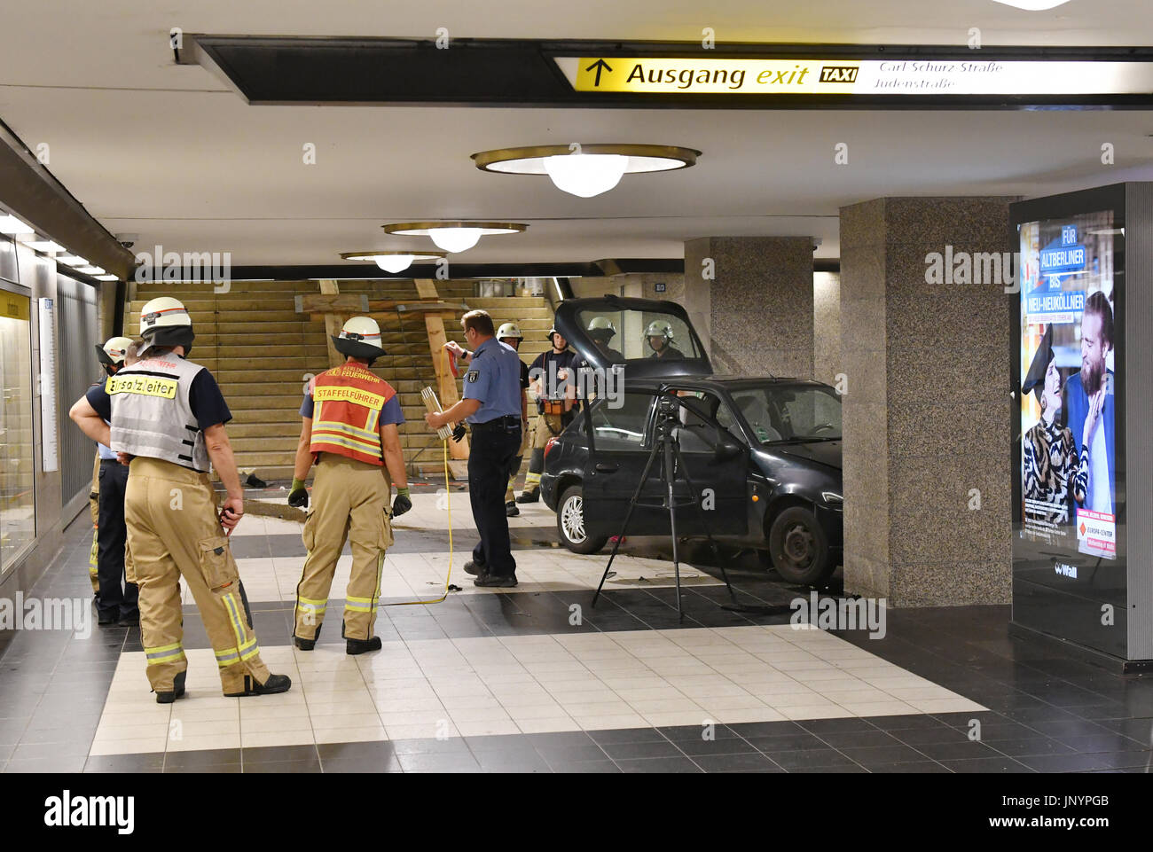 Berlin, Germany. 30th July, 2017. A car can be seen in the underground station Rathaus Spandau in Berlin, Germany, 30 July 2017. After a car chase with the police the driver of the Fiesta drove down the stairs to the tracks. The car appeared conspicuous to the police because there had been a search warrant for the number plates of the vehicle. The driver has been arrested. Photo: Paul Zinken/dpa/Alamy Live News - Stock Image