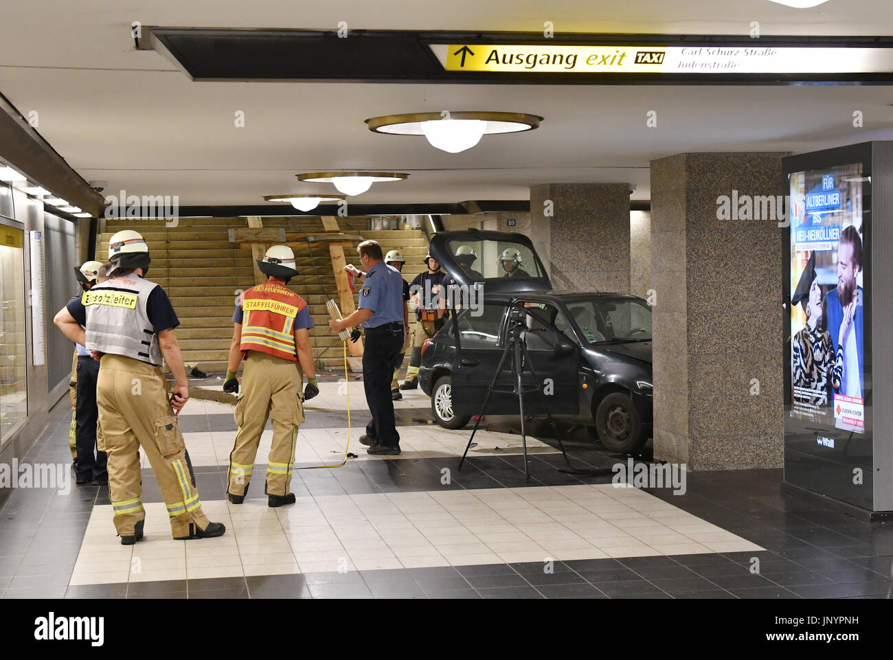 Berlin, Germany. 30th July, 2017. dpatop - A car can be seen in the underground station Rathaus Spandau in Berlin, Germany, 30 July 2017. After a car chase with the police the driver of the Fiesta drove down the stairs to the tracks. The car appeared conspicuous to the police because there had been a search warrant for the number plates of the vehicle. The driver has been arrested. Photo: Paul Zinken/dpa/Alamy Live News - Stock Image