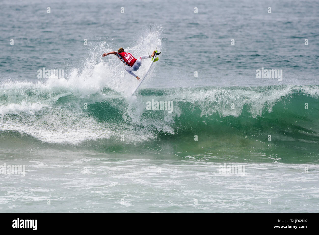 Huntington Beach, USA. 31 July, 2017. Kolohe Andino (USA) rotates above the lip during his round 2 heat win at the 2017 VANS US Open of Surfing. Credit: Benjamin Ginsberg/Alamy Live News. - Stock Image
