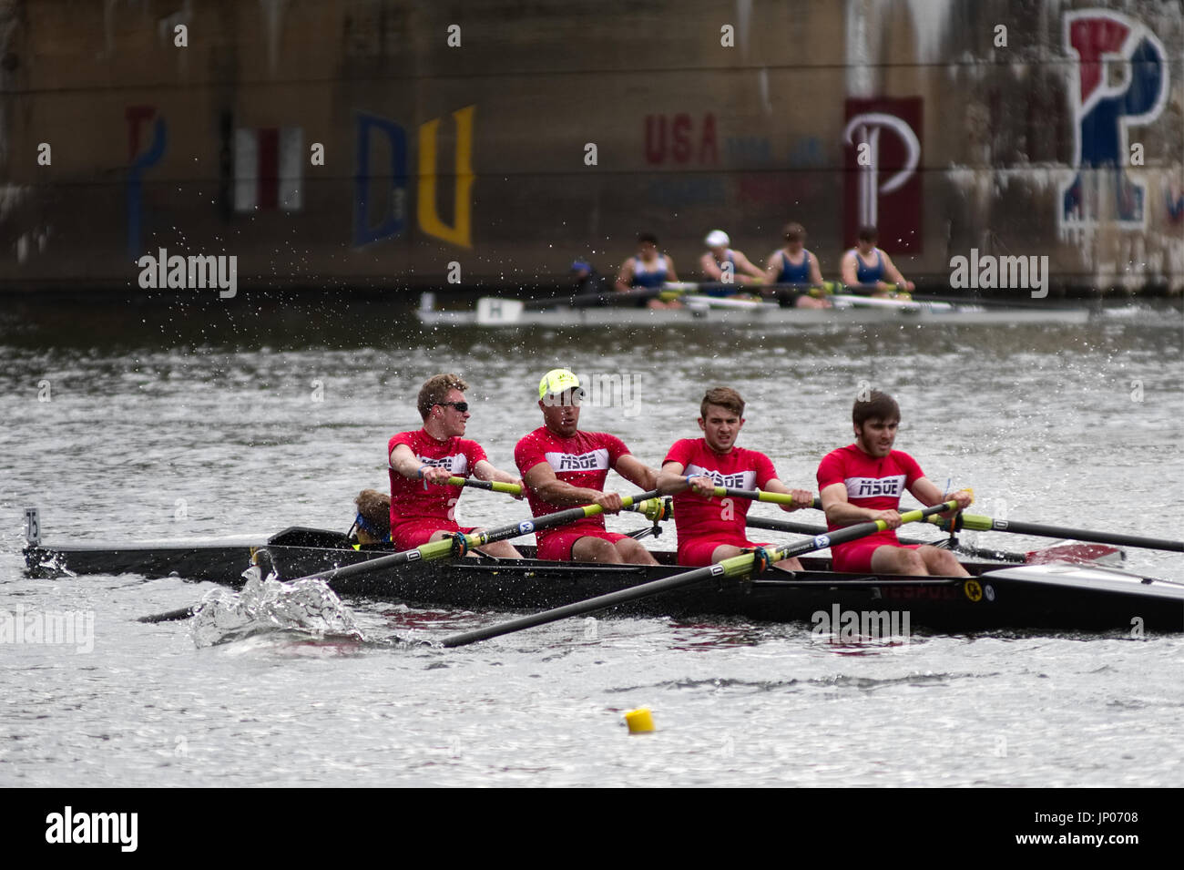Members of a collegiate crew compete in the annual Dad Vail Regatta on the Schuylkill River in the Fairmount Park section of Philadelphia, PA - Stock Image