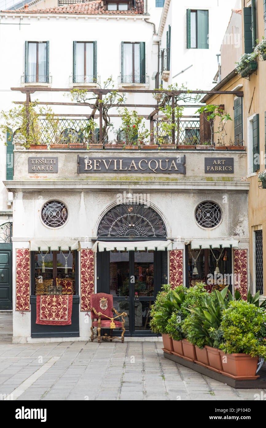 Venice, Italy - April 23, 2012: Bevilacqua fabrics shop near St. Mark's Square in Venice, Italy - Stock Image