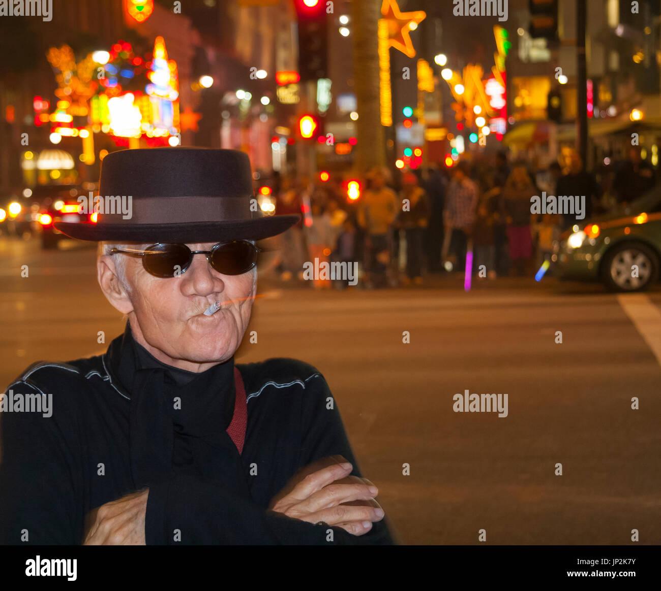 Michael J Pollard on the street at Hollywood Highland smoking - Stock Image