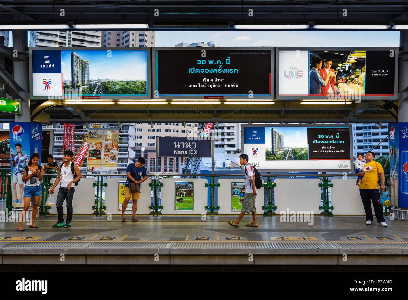 People waiting for the skytrain (BTS on Nana station in Bangkok, Thailand. - Stock Image