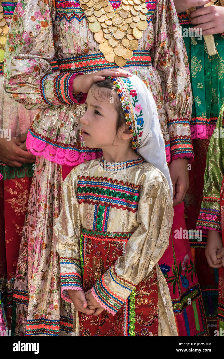 Dressed girls with gold coin necklaces, Assumption Day, Olympos, Karpathos Greece Stock Photo